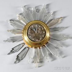 Art Deco Clock Brass, glass, wood 20th century Circular dial with glass buttons at hour locations, circular stepped case fr