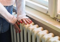 Photo about Home central heating system, woman`s hands on an old and robust metal radiator. Image of heater, domestic, metal - 106695879 Touring Caravans For Sale, Small Washing Machine, Home Heating Systems, Radiator Valves, Cast Iron Radiators, Heating And Air Conditioning, Central Heating, Heat Pump