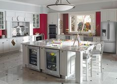 Traditional, white kitchen suite with matching stainless steel appliances.
