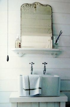 vintage mirror, interesting sink, painted wood paneling from the book pale and interesting