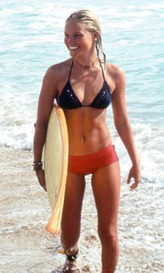 KATE BOSWORTH Blue Crush, 2002  Kate Bosworth was basically unknown when she was picked to star as the hard-core surfer girl at the center of 2002?s Blue Crush. Her mis-matched suit?like the muscular frame it displayed?was both sexy and functional.