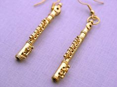 Flute Earrings gold  Instrument Music Orchestra gold plated Musician Band Miniblings. €19.99, via Etsy.