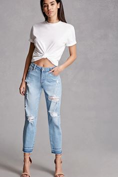 A pair of mid-rise boyfriend jeans by Twelve™ featuring a distressed design, zipper fly, five-pocket construction, braided belt loops, and a raw-cut hem.