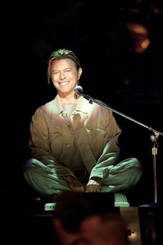 "This is Bowie opening the 9/11 heroes benefit concert in New York City. You will notice that he is sitting cross legged at the front edge of the station with a very small keyboard in front of him that he used as his only accompaniment. He opened with the archetypal ""America"" by Simon and Garfunkel then went into ""Heroes"" after thanking his local fire house. Apparently, Bowie was all over the city firehouses after 9/11 checking in with survivors just to see what he could do and how they were."