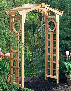 "The Longevity Cedar Arch creates a graceful, elegant entry to your garden or yard. Perfect for an Asian-themed garden, the peak of the graceful, upswept gable is accented with the Chinese symbol for longevity embossed on a brass medallion. Distinctive circular ""windows"" complete the style. Open, airy lattice on the sides is ideal for supporting flowering vines.    $429.00"