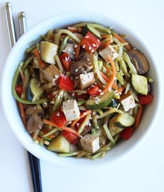 Next time you're craving a bowl of Chinese takeout, opt for this low-carb broccoli slaw stir-fry with zucch...