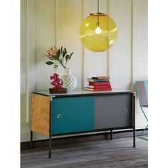 Shop Dupla Credenza - SOLD OUT. The Dupla Credenza was created exclusively for in partnership with husband-and-wife design duo Robert and Cortney Novogratz. Tropical Centerpieces, Steel Canopy, Bring Them Home, Antique Lighting, White Vases, Wall Sconces, Home Decor, Pendant Lamps, Pendant Lights