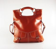 I see an orange purse in my future - not necessarily this one though, I am more of a 30 dollar purse type of gal. ;)
