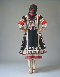 """The older bridal version of the Makra Gefyra (Zaloufi) festive dress with its embroidered overcoat known by the name of """"terliki"""". A special effect is created by the white felt boots.  Size   Date Early 20th c"""