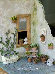 Intrigued by these small models of just part of a scene for indoor display - maybe a New Orleans balcony with clambering bougainvillea, or a Greek home with bright details and flowers