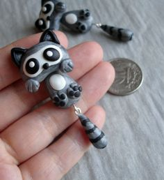 GUO GUO'S- Handmade polymer clay raccoon Ear Stud, Made to order. $23,00, via Etsy.