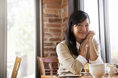 Chinese woman drinking coffee in cafe - Chinese woman drinking coffee in cafe