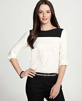 Button Sleeve Colorblock Top - Cleverly colorblocked for a striking play of contrasts, this wear-now piece boasts button tab sleeves that roll up or down for a versatile work-to-weekend look. Jewel neck. Long sleeves with button tabs. Front and back yoke. Back inverted pleat. Shirttail hem.