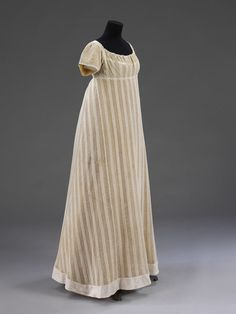 1812 striped dress | V&A Dress made of warp-knitted fabric, probably cotton. With a pattern of alternating stripes of close 'plain' knitting and open work. The sleeves and a band inserted around the neck are also in knitted cotton with a smaller pattern of alternating plain and open work.