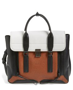 Stunning, sleek and totally chic- this tri-colored 3.1 Phillip Lim leather satchel is going to be a fall staple.