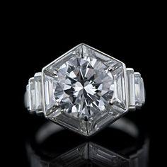 van cleef 3.01 carat round diamond ring with hexagon halo