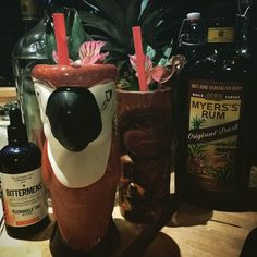 Second drink moving on with a run punch in some tiki mugs. #tiki #tikibar #pineapple #homebar #homebartender #parrotmug #parrot #tikimug #meyersrum #alstroemeria #tikiman #bitters #rum