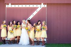 Bride & Bridesmaids in front of barn   Strawberry Farms Wedding, Photography by The Youngrens