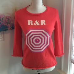 "Kate Spade Coral Intarsia Sweater Coral sweater with ""R&R"" and giant target-like umbrella top detail on front. Soft fringed sleeves and hem. Worn once, 100% Cashmere. Feel free to make an offer! kate spade Sweaters Crew & Scoop Necks"