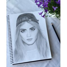 Art and drawing made by myself. Cara delevingne, flower in the background (campanula)