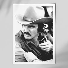 Burt Reynolds - Smokey and the Bandit. Read more about the Smokey and the Bandit Movies and the favorite characters Bo, Darville, Carrie and Sherrif Justice. Ranger, Smokey And The Bandit, Burt Reynolds, Original Movie Posters, Black And White Portraits, Hollywood Stars, Hollywood Icons, Looks Cool, American Actors