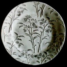 """cinoh:  Assiette Plate, handmade in Paris, France by Astier de Vilatte Astier de Vilatte is known for their white-glazed """"black terracotta"""". A cunning mix of high-design and rustic handcraft, I think. Please do check out the rest of the collection."""
