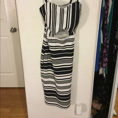 Charlotte Russe black and white stripe dress ! This is an awesome black and white striped tight dress from Charlotte Russe! Super cute for going out has a middle key hole in front of dress! Super flattering great condition! Great for a night out ! Charlotte Russe Dresses Midi