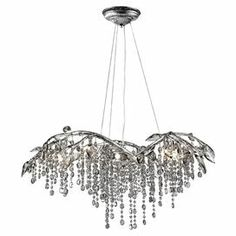 Bring organic-chic style to your living room, dining room, or foyer with this beautiful chandelier, showcasing a branch-inspired silhouette and cascading crystal accents.    Product: ChandelierConstruction Material: Steel and crystalColor: Mystic silverFeatures: Cascading crystals are used to romantically diffuse the lightAccommodates: (6) 20 Watt halogen type G4 bulbs - includedDimensions: 14.25'' H x 31'' Diameter Note: Assembly required