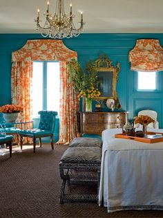 dark teal paint, orange curtains, gold mirror