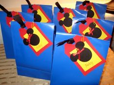 Mickey Mouse Candy Bags Ideas - DIY - buy lunch sack bags. Cut out the Mickey Mouse head icon. The tags can be used to personalize what candy bag goes to who. I really wouldn't pick the blue bag. It makes it look like Superman theme. I'd rather go with a black bag.