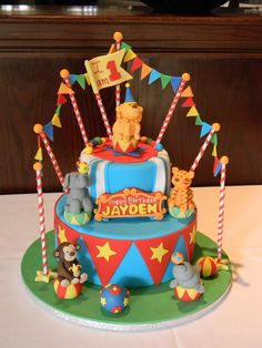 A super special first birthday circus cake, with fondant animals and bunting www.cafeattila.com