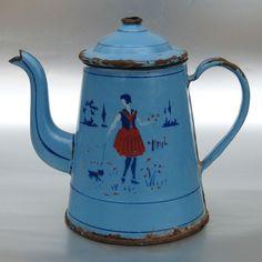 Vintage French enamelware teapot...girl with dog. LOVE it! But at $149' I'll have to admire from afar...