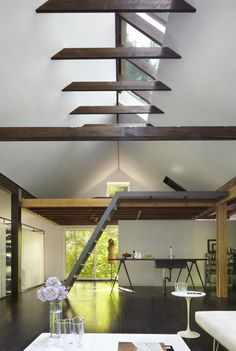 Vaulted ceiling with skylights and exposed ceiling roof ties