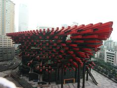Chongqing Guotai Arts Center. Designed by Hunter Douglas Contract to resemble chopsticks and a hotpot