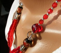Long necklace made of Czech beads and faceted glass rondels. Supplemented by large lampwork beads handmade. The main color is red. Length 66 cm. Clasp - steel lobster.