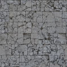 TEXTURE Pavement texture consisting of cracked, rectangular tiles in grey color.