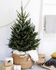 Add Scandi style to your tree by placing it into a natural basket and draping the trunk with snow-white sheepskin.