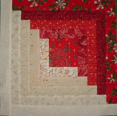 Red and cream log cabin block.