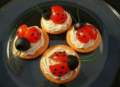 Mayo Beetle Canapé- This could be a perfect and instant evening snack! Decorate a salty biscuit with wipped mayo with a lil tabasco sauce n garish wid cherry tomatoes and some olives :) njoy