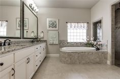 Great use of stone, tile and marble in this bathroom