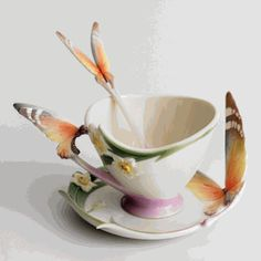 I love Franz porcelain! I would love to have a whole collection of their fanciful cups and saucers.
