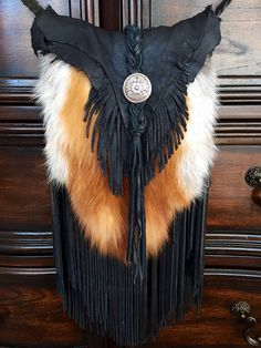 This bag is made from authentic amazingly soft high grade fox fur, and premium soft deer skin leather. This unique bag is one of a kind and is a must for anyone looking to make a fashion statement. From start to finish, this bag has been made completely by hand and will last for a