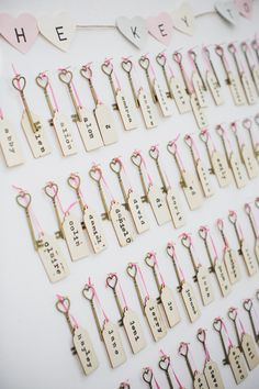 "tietheknotonthehighstreet feature - ""We made our own plan using vintage-style keys and luggage tags. For every guest, we labelled one of the keys with a gift tag that had their name and table number on. We hung all the keys up on a board with the words 'the key to your seat' spelled out in paper bunting and the guests had to find their key to work out which table they were on."""