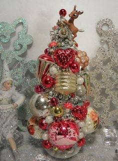 Reminds me of Ava...Ms Bingles Vintage Christmas: Last of the Bottle Brush Trees!