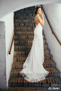 Lace wedding dress made by Pukuni (www.pukuni.fi). Open back, lace train, bride, stairs, castle.