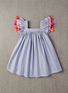100% viscose A-line dress with pom poms on sleeves in Blue Pin Stripe. * PRE-ORDER. The estimated shipping date for this item is: 04/7/2016. This item is availa