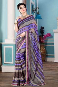 Beige Grey Chiffon Saree with Art Silk Blouse Price:-£29.00 New arrival Beige Grey Chiffon Saree with Art Silk Blouse and Printed Pallu, Round Neck Blouse, Short Sleeve. This is prefect for party wear, wedding, festival, casual, ceremonial. These designs are presented by Andaaz Fashion http://www.andaazfashion.co.uk/beige-grey-chiffon-saree-with-art-silk-blouse-dmv7858.html
