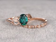 Emerald engagement ring set in BBBGEM,we offers natural and lab-treated emerald wedding set in rose gold,yellow gold and white gold.