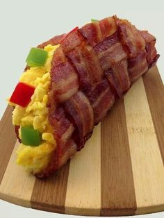 Bacon breakfast taco Directions: Weave the raw bacon like a basket, trim where necessary, use a cupcake or taco shaped metal mold/pan and put it in the oven at 360and bake until crispy. Stuff it with ur favorite scrambled eggs recipe. Enjoy!!!!!!