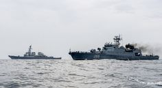 USS Porter (DDG-78), left, and the Romanian naval ship ROS Marcellariu (265), right, transit through the Black Sea during a passing exercise on July 14, 2015. US Navy Photo